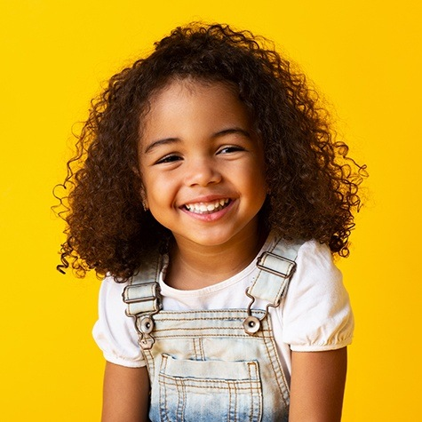 Little girl smiling after pulp therapy