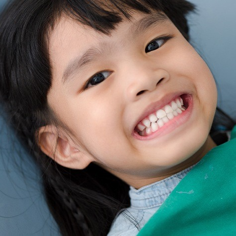 Child smile in dental office thanks to sedation dentistry