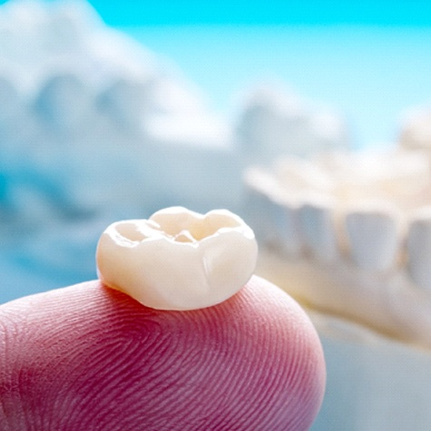 Close-Up of Dental Crown on a Person's Finger