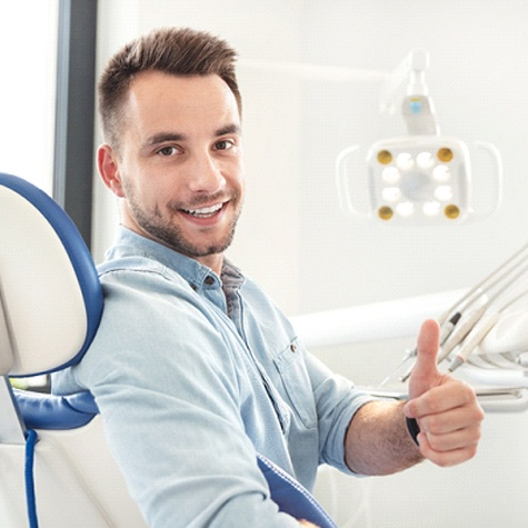 Man in dental office giving thumbs up; dentist in Doylestown, PA