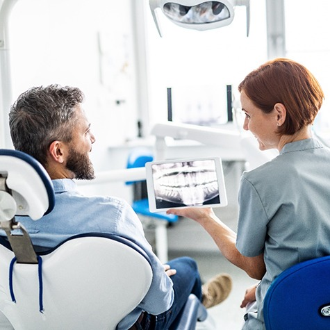 Man talking to dentist about sinus lift