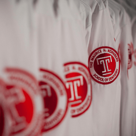 Temple University Dental School logo on lab coats