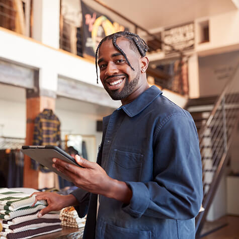 smiling business owner taking inventory