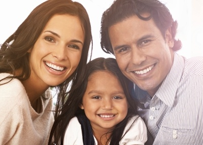 Smiling family after preventive dentistry
